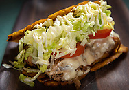 Jibarito, a fried plantain sandwich with a choice of steak or pork, swiss-american cheese, lettuce, tomatoes and garlic mayo on twice fried green plantains at Mayo Ketchup by Plantain Girl Thursday, Nov. 14, 2019 in the Lafayette Square neighborhood of St. Louis. The fast casual restaurant serves Puerto Rican, Dominican and Cuban food. Photo © copyright 2019 Sid Hastings.