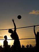 Playing volleyball in Waikiki with a beautiful Hawaiian sunset.