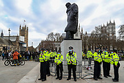 Police stand guard around the statue of wartime prime minister Winston Churchill in Parliament Square during a 'Kill the Bill' protest in London on Saturday, April 3, 2021. The demonstration is against the contentious Police, Crime, Sentencing and Courts Bill, which is currently going through Parliament and would give police stronger powers to restrict protests. The statue had been defaced during anti-racism protests last year. (Photo/Vudi Xhymshiti)