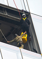 © London News Pictures. 03/09/2012. London, UK.  Prince Andrew being helped in to a  midpoint of his descent.  Prince Andrew, The Duke of York abseiling down The Shard building in Central London on September 3, 2012. The Prince joined Ffion Hague billionaire John Caudwell and a team of 37 others to take part in a charity abseil down London's tallest building to raises funds for The Outward Bound Trust and the Royal Marines Charitable Trust Fund. Photo credit: Ben Cawthra/LNP
