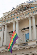 A huge rainbow flag hangs outside the Institute of Directors building on Pall Mall on the 5th July 2018 in London in the United Kingdom. London embraces equality ahead of Pride London Festival.