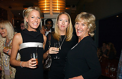 Left to right, sisters the HON.SOPHIA HESKETH and the HON.FLORA HESKETH with ANNABEL ELLIOT sister of HRH The Duchess of Cornwall at a party to celebrate the publication of 'The year of Eating Dangerously' by Tom Parker Bowles held at Kensington Place, 201 Kensington Church Street, London on 12th october 2006.<br /><br />NON EXCLUSIVE - WORLD RIGHTS