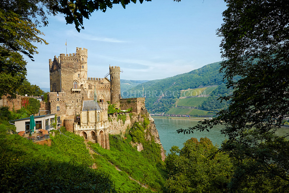 View of the Rheinstein (Burg) Castle, and cafe settled above the Rhine River, Trechtingshausen, Germany.