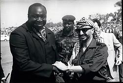 Sep. 09, 1975 - Arafat at Oau summit, Kampala Arriving at Entebbe Airport to attend the Oau Heads of stats summit as an observer, Yassir Arafat is greeted by a jubilant Idi Amin -- for once in civilian dress. Credit : Camerapix (Credit Image: © Keystone Press Agency/Keystone USA via ZUMAPRESS.com)