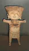 A laughing face representing a child sacrificed to the rain god Tlaloc. Earthenware Veracruz culture, 300 - 1200 AD, Mexico