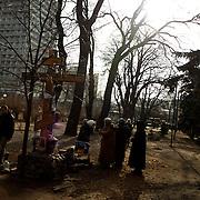 KIEV, UKRAINE - February 24, 2014: People pray at a shrine in a park beside Ukraine's parliament building in Kiev. CREDIT: Paulo Nunes dos Santos