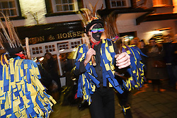© London News Pictures. 05/01/2018. Hartley Wintney, UK. Hook Eagle Morris Men dancing a stick dance during a torch-lit parade as part of a Wassailing tradition in the town of Hartley Wintney in Hampshire, England. Wassail is a traditional Pagan winter celebration in cider-producing regions of England, reciting incantations and singing to the trees to promote a good harvest for the coming year. Photo credit: Ian Longthorne/LNP