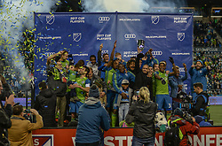 November 30, 2017 - Seattle, Washington, U.S - Soccer 2017: The Seattle Sounders team celebrates winning the Western Conference title and share the trophy at the post-game awards ceremony. The  Sounders beat the Houston Dynamo 3-0 in the MLS Western Conference Finals match at Century Link Field in Seattle, WA. (Credit Image: © Jeff Halstead via ZUMA Wire)