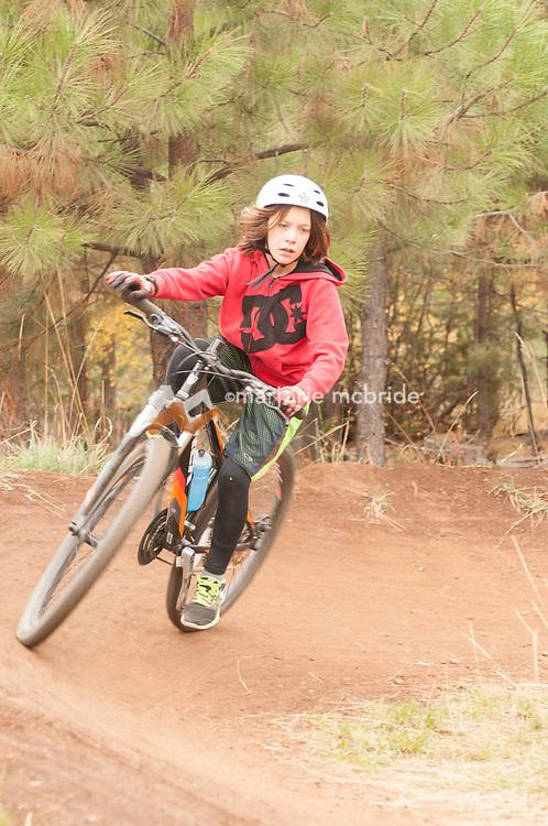 Boy on the pump track,  mountain biking Bear Basin during autumn, McCall, Idaho. MR