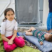 Daniel 1 year and 8 months old from Teheran, Iran sleeps next to Mohadisha 9 years old at Moria camp, Lesvos, Greece.