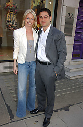 CEM & CAROLINE HABIB at an exhibition of photographs by David Montgomery entitled 'Shutterbug' held at Scream, 34 Bruton Street, London W1 on 13th July 2006.<br /><br />NON EXCLUSIVE - WORLD RIGHTS