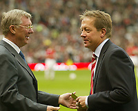 Photo: Aidan Ellis.<br /> Manchester United v Charlton Athletic. The Barclays Premiership. 07/05/2006.<br /> Alan Curbishley recieves a flight for two to new Zealand from Alex Ferguson