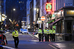 © Licensed to London News Pictures. 03/02/2020. LONDON, UK. Police on Frith Street. Scenes in Soho where the public have been evacuated by police and emergency services are in attendance after reports of an unexploded WW2 bomb being discovered in the area.  A wide cordon has been established from Shaftesbury Avenue, Charing Cross Road and the streets around Old Comption Street.  Photo credit: Stephen Chung/LNP