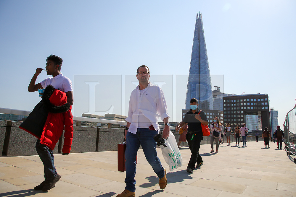 © Licensed to London News Pictures. 14/09/2020. London, UK. Fewer people on London Bridge on a warm and sunny day as the mini heatwave continues in the capital. The bridge would normally be busy with tourists during sunny weather. The government has announced that gatherings of more than six people are banned from today as the numbers of COVID19 cases have started to increase. Photo credit: Dinendra Haria/LNP