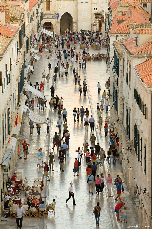 Europe, Croatia, Dalmatia, Dubrovnik.  Pedestrians fill the Stradun (also known as Placa), the main street which crosses the old city, elevated view.  The historic center of Dubrovnik is a UNESCO World Heritage site.