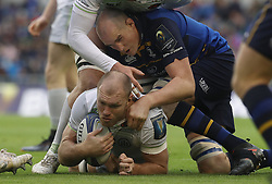 Leinster's Devin Toner tackles Saracens' Schalk Burger during the quarter final of the European Champions Cup match at The Aviva Stadium, Dublin.