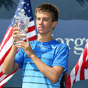 Borna Coric, Croatia, with his trophy after defeating Thanasi Kokkinakis, Australia, during the Junior Boys' Singles Final at the US Open. Flushing. New York, USA. 8th September 2013. Photo Tim Clayton