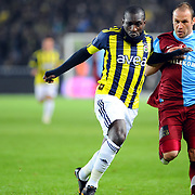 Fenerbahce's Mamadou NIANG (L) and Trabzonspor's Serkan BALCI (R) during their Turkish superleague soccer derby match Fenerbahce between Trabzonspor at the Sukru Saracaoglu stadium in Istanbul Turkey on Sunday 30 January 2011. Photo by TURKPIX