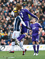 Photo: Steve Bond/Richard Lane Photography. West Bromwich Albion v Newcastle United. Barclays Premiership. 07/02/2009. Marc-Antoine Fortune (L) and Fabricio Coloccini (R) in the air