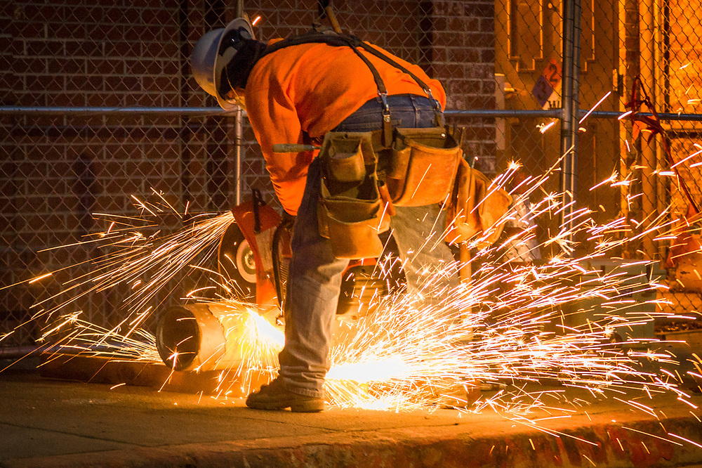 Jim cuts a pipe at the end of the work day on the Lincoln Avenue Bridge project in Calistoga.