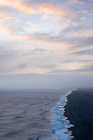 View at sunset over the south coast of Iceland from Dyrhólaey Peninsula, viewing west. South Iceland.