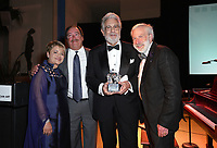 Opera Maestro Plácido Domingo, the first honoree of the LEGADO: A Legacy for the Arts Award, accepted accolades and trophy  (Pictured left to right: MOLAA President and CEO Lourdes Ramos-Rivas, Board Co-Chair Mike Deovlet, Domingo, and Board Co-Chair Robert Braun during the MOLAA Gala 2018 held at Museum Of Latin American Art on October 05, 2018 in Long Beach, California, United States (Photo by JC Olivera)