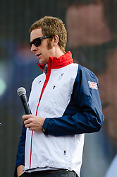 © Licensed to London News Pictures. 04/08/2012. London, UK. Bradley Wiggins, Team GB Olympic Cyclist, being interviewed by Johnny Vaughan on stage at BT London Live, Hyde Park.   Bradley Marc Wiggins, CBE (born 28 April 1980) is a British professional track and road racing cyclist, riding for the UCI ProTeam Team Sky. Wiggins began his career on the track, but has made the transition to road cycling, becoming one of the few cyclists to gain success in both disciplines. He won the 2012 Tour de France, becoming the first British winner in its 99-year history, and has achieved the historic double of Tour de France crown and Olympic gold where he won the Time Trial by a huge 42 second margin in time trial over 27.3 mile south-west London course. He is now Britain's most decorated Olympian, overtaking Steve Redgrave.  BT London Live is series of events across London that combe multiple state-of-the-art screens and concert quality sound systems to show all of the London 2012 events.   Photo credit : Richard Isaac/LNP
