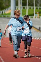 Sheffield Half Marathon Fun Run Sunday Morning.One young girl makes the finish line despite a cut knee..12 May 2013.Image © Paul David Drabble