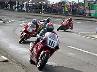 NW200 Motorcycle Racing - Bikes coming out of the York Corner at Portstewart, N Ireland.  Picture taken 16 May 1998 at NW200 Motorcycle Races, Coleraine, N Ireland.  Ref: 199805048..Copyright Image from Victor Patterson, 54 Dorchester Park, Belfast, UK, BT9 6RJ..Tel: +44 28 9066 1296.Mob: +44 7802 353836.Voicemail +44 20 8816 7153.Skype: victorpattersonbelfast.Email: victorpatterson@mac.com.Email: victorpatterson@ireland.com (back-up)..IMPORTANT: If you wish to use this image or any other of my images please go to www.victorpatterson.com and click on the Terms & Conditions. Then contact me by email or phone with the reference number(s) of the image(s) concerned.