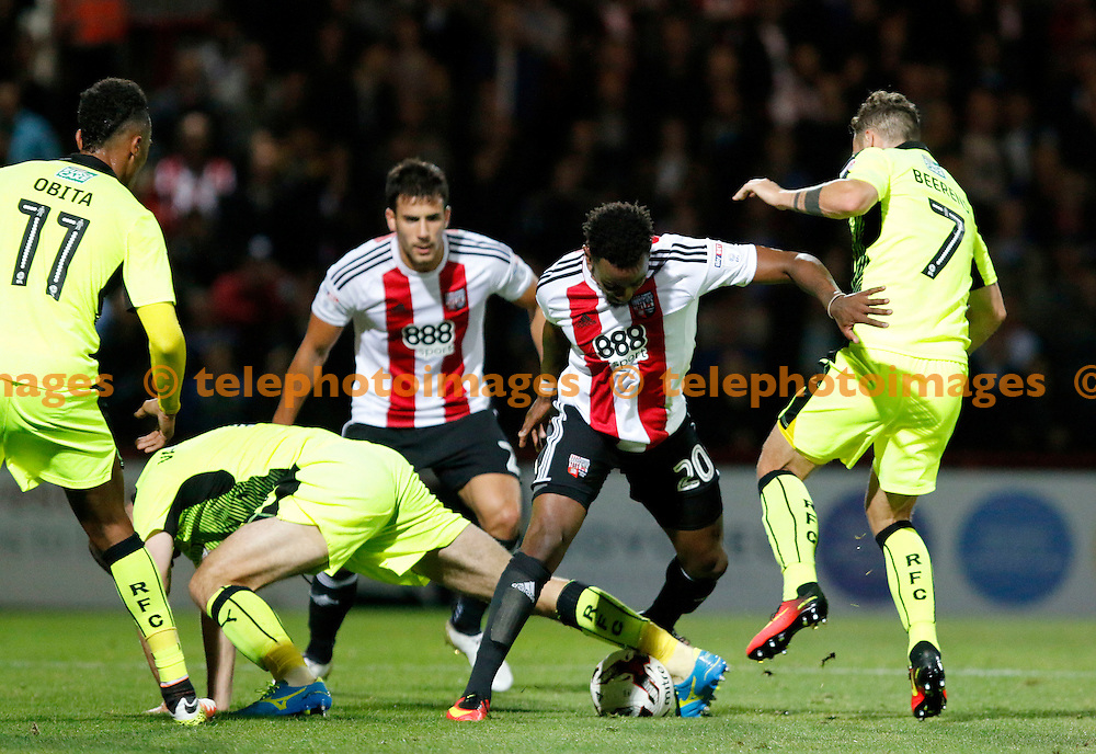 Brentford's Josh Clarke takes on 3 during the Sky Bet Championship match between Brentford and Reading at Griffin Park in London. September 27, 2016.<br /> Carlton Myrie / Telephoto Images<br /> +44 7967 642437