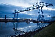 The Tees Transporter Bridge at dusk overlooking the River Tees, Middlesbrough, North Yorkshire, United Kingdom. Tees Transporter Bridge is one of England's most iconic bridges and is a Grade II listed building, meaning it is of special interest and requires every effort to be preserved.