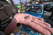 9. Herbst Treffen der Trabant Fahrer zum traditionellen Ausklingen der Auto Saison 2007 in Prag. Mini Trabant auf einer Hand. Ein halbes Jahrhundert ist vergangen, seit 1957 die Nullserie des Trabant P50 die Werkhallen in Zwickau verliess. Bis 1991 wurden über 3 Millionen Trabant produziert, der Trabant gehörte über Jahrzehnte zum Straßenbild vieler europäischer Länder.  <br /> <br /> 9th Trabant driver meeting and end of the car season 2007 in Prague. Miniature Trabant on a hand.