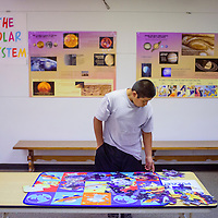072215       Cable Hoover<br /> <br /> Jerrell Martinez looks at a puzzle game that is part of the Exploring Space exhibit at the Octavia Fellin Public Library in Gallup Wednesday.