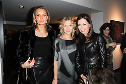 Left to right, MASHA MARKOVA, GALINA MAZAEVA and KATYA FOMICHEV at a private view of photographs by Guido Mocafico entitled 'Guns and Roses' held at Hamiltons Gallery, 13 Carlos Place, London W1 on 21st January 2010.