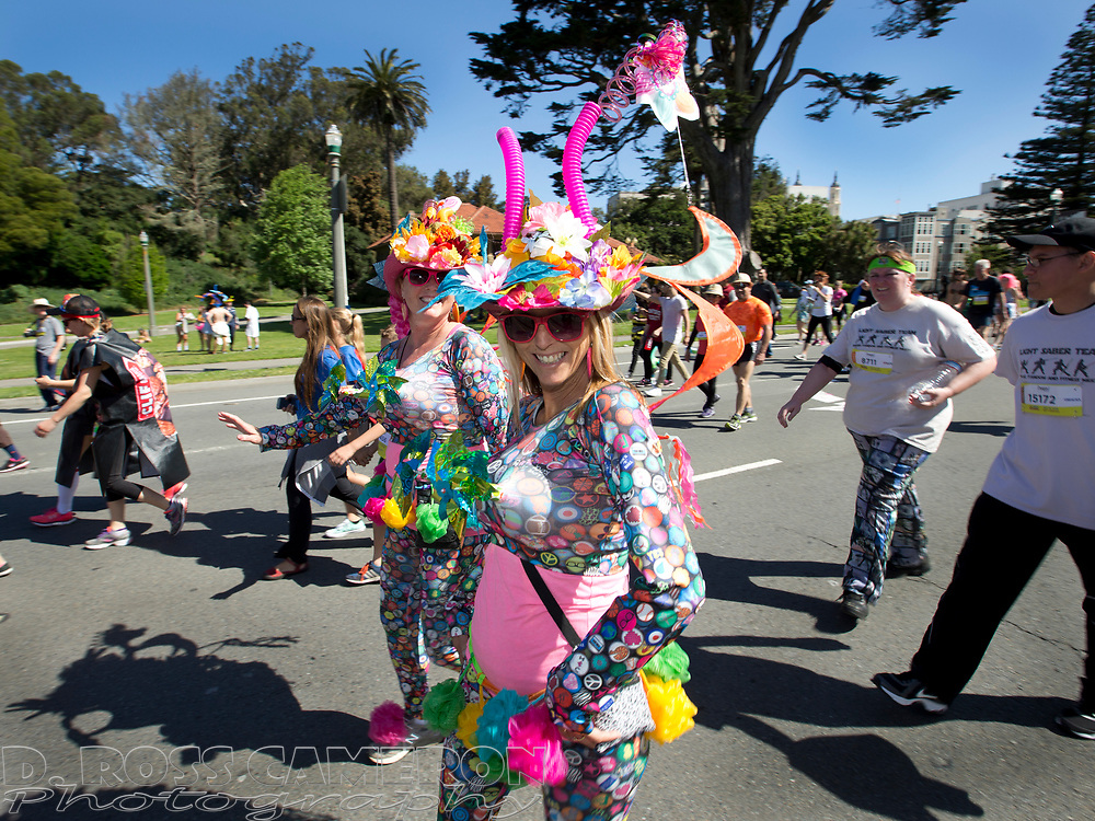 Twenty-first century flower children pass through Golden Gate Park during the 105th running of the Bay to Breakers 12k, Sunday, May 15, 2016 in San Francisco. The 7.42-mile race from San Francisco Bay to the Pacific Ocean, which attracts a field of tens of thousands of runners, from elite runners to weekend warriors, some clad in costume and some in nothing at all. (Photo by D. Ross Cameron)