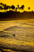 A couple during sunset on the beach at Aguadilla Puerto Rico