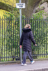 © Licensed to London News Pictures. 31/03/2020. London, UK. A women walks past a queue sign in Church Road Wimbledon. AELTC is set to announce on Wednesday (1 April) the cancellation of the Wimbledon Tennis Championships 2020 due to the coronavirus pandemic. The pandemic has led to the cancellation of major sporting events across the World as the coronavirus crisis continues. Photo credit: Alex Lentati/LNP