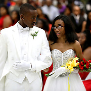 Escort Zion Justice and debutante Tiara Jones quietly exchange a few words after Tiara was presented during the cotillion hosted by the Toledo Club of the National Association of Negro Business and Professional Women's Clubs hosted at the Stranahan Great Hall in Toledo on Saturday, May 26, 2018. THE BLADE/KURT STEISS