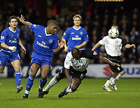 Picture: Henry Browne.<br />Date: 20/12/2003.<br />Fulham v Chelsea  FA Barclaycard Premiership.<br />Luis Boa Morte of Fulham is knocked down by Glen Johnson.