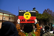 Protesters hold up signs at Parliament House during a 'Black Lives Matter' rally on 02 June, 2020 in Sydney, Australia. This event was organised to rally against aboriginal deaths in custody in Australia as well as in unity with protests across the United States following the killing of an unarmed black man George Floyd at the hands of a police officer in Minneapolis, Minnesota. (Photo by Steven Markham/ Speed Media)