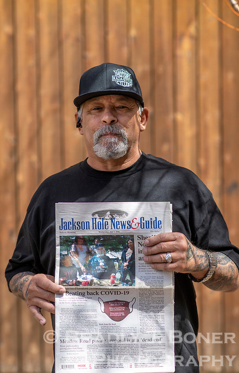Anthony Parker holds a copy of the July 1, 2020 editon of the Jackson Hole News&Guide with a story about his release from the hospital after spending almost three months battling COVID-19. Ten months later, Parker is still rehabbing from the disease that almost killed him and subesequently impacted just about every part of his body.