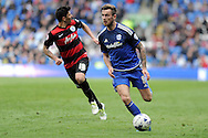 Cardiff City's Joe Ralls breaks through the QPR defence. Skybet football league championship match, Cardiff city v Queens Park Rangers at the Cardiff city stadium in Cardiff, South Wales on Saturday 16th April 2016.<br /> pic by Carl Robertson, Andrew Orchard sports photography.