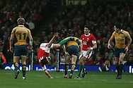 Australia's Peter Hynes collides with Tom James of Wales. Invesco Perpetual series, Wales v Australia at the Millennium Stadium on Saturday 28th Nov 2009.  pic by Andrew Orchard, Andrew Orchard sports photography, .EDITORIAL USE ONLY