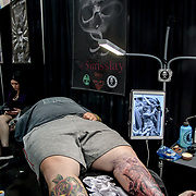 Ink Therapy by Sirris Slay, Tattoo a client at The Great British Tattoo Show, on 26 May 2019, London, UK.