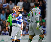 Photo: Leigh Quinnell.<br /> Queens Park Rangers v Southampton. Coca Cola Championship. 01/09/2007. QPRs Martin Rowlands has a strong word with Southampton goalkeeper Kelvin Davis.
