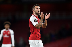 Arsenal's Jack Wilshere applauds fans after the final whistle