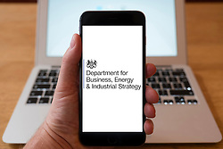 Using iPhone smartphone to display logo of Department for Business , Energy & Industrial Strategy