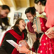 A bride and bridesmaids laugh at a selfie.