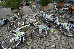 Overturned rental bikes on street in Berlin, Germany