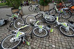 Overturned rental bikes on street in Berlin, Germany